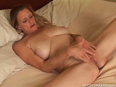 Mature trailer trash amateur with big tits plays with her fat wet pussy