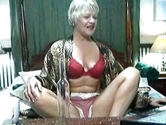 Cam granny with nice natural tits has fun stripping for an audience
