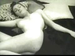 Slim vintage brunette in the nude has perky breasts and a tempting ass