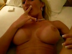 German wife with a blazing hot body blows her husband and takes his cum