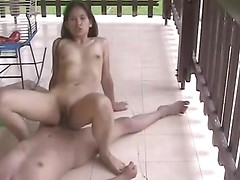 Small-titted oriental girl fucks with horny man