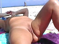 Voyeur movie with mature bitch masturbating naked on the beach