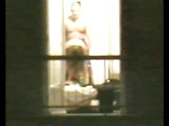 Spying on a couple through their bedroom window catches a doggystyle quickie