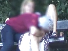 Grey haired guy and his lovely wife fool around on a park bench with full finger fucking action