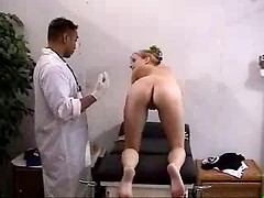 At a naughty gyno exam she strips fully nude and has her pussy and ass fingered
