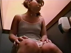Teen with pigtails pissing in the public toilet