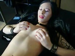 Goth girlfriend with great tattoos gives a titjob to make her man cum