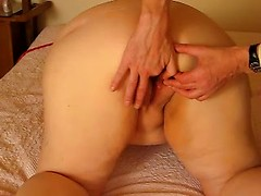 Fat ass wife as her face down and her booty up so hubby can finger her slutty holes