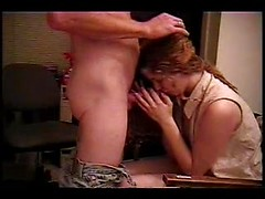 British cutie in a blouse and panties leans forward and erotically blows her husband