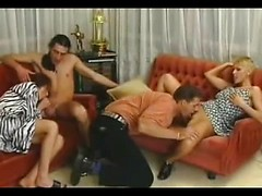 Euro ladies in sexy dresses blow their boyfriends and fuck in a classic foursome