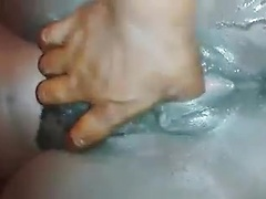 Slippery cunt juices pour from her aroused ebony pussy as he fingers her