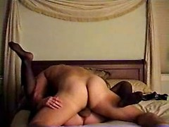 Horny mature bitch in stockings gets hardcore drilled on bed
