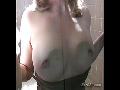 Amateur busty housewife washing shower cabin with her tits naked