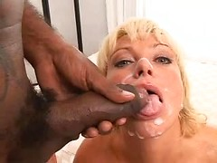 Cute white girl with gorgeous big eyes sucks black dick and gets a facial