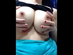 Huge round Asian tits look amazing in her soft hands and as she sucks the nipples