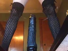 Amateur cam slut sits her shaved pussy down on the biggest black dildo of her life